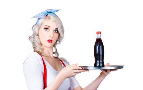 Pinup girl waiter with soda
