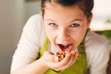 Funny Girl eating walnuts
