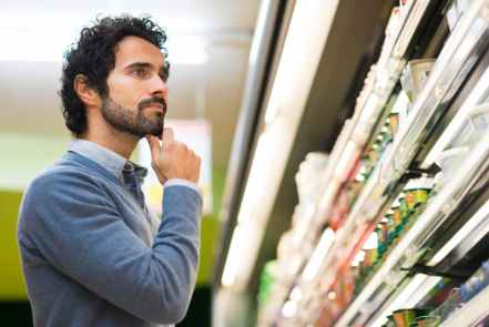 Man choosing the right product in a supermarket