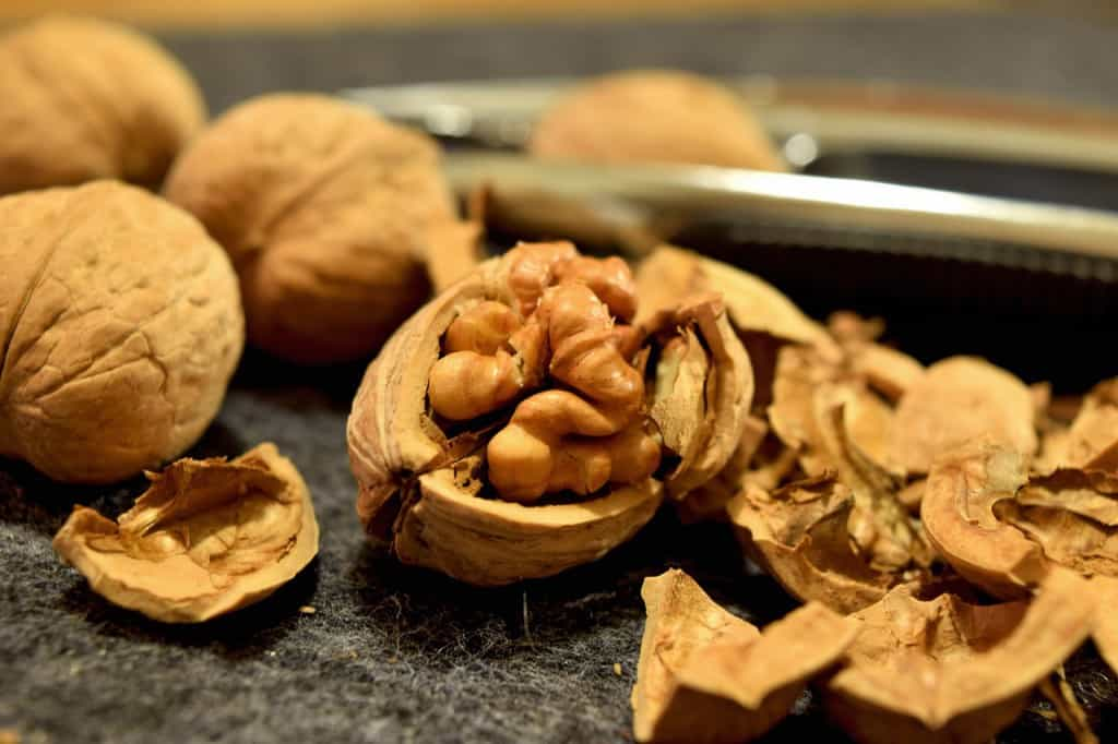 Cracked and whole walnuts on a table