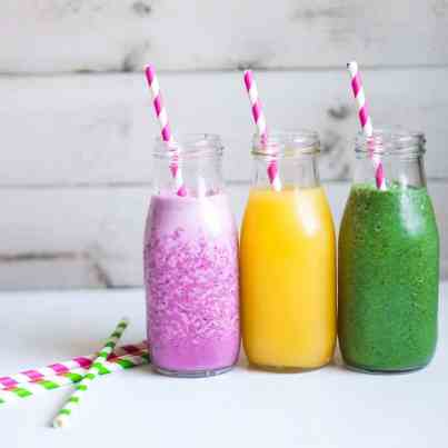 Three smoothies with berries,fruits and greens