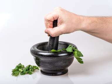 Herbs crushed by a mortar