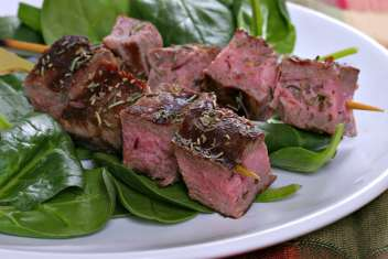 Beef Steak Skewers Over Spinach
