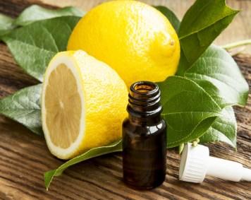 Lemon essential oil with lemons