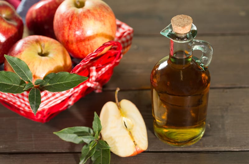 Apple cider vinegar on a table