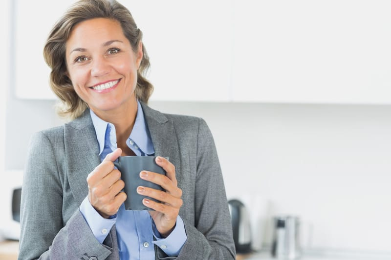 Happy woman with coffee