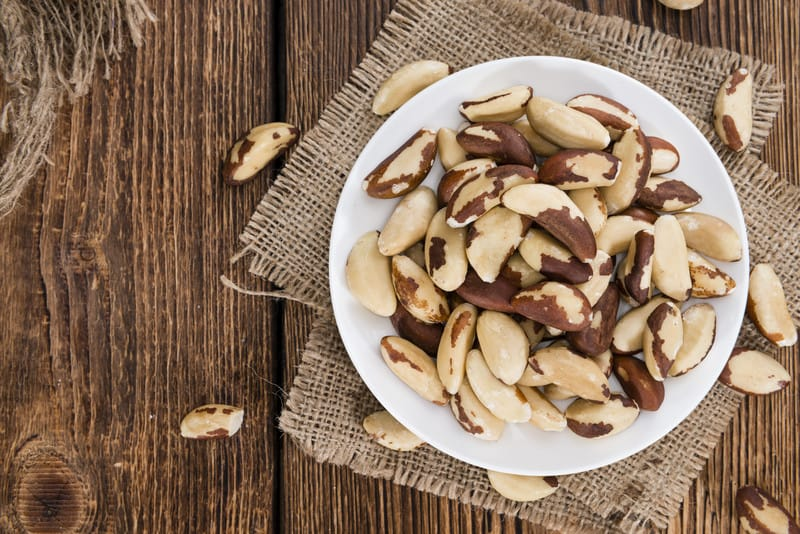 Brazil nuts in a bowl on a table