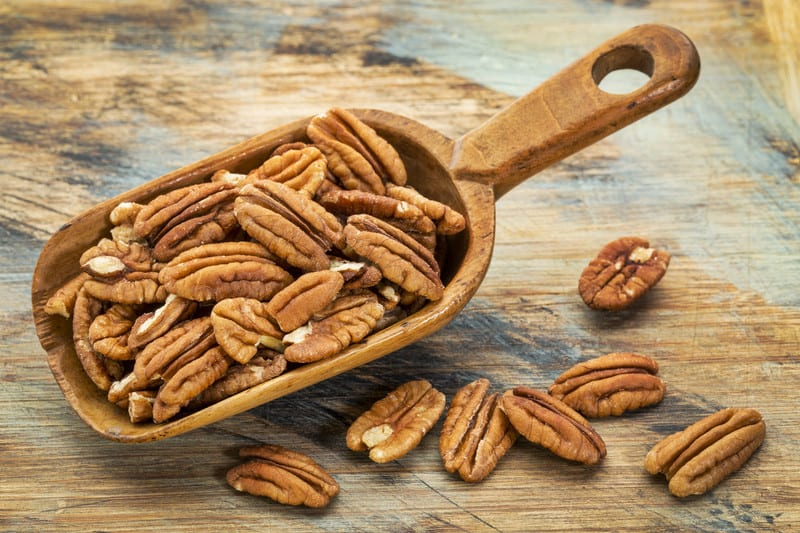 Scoop of pecan nuts