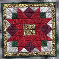 poinsettia needlepoint ornament designed by needlepoint expert janet m. perry