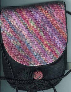 needlepoint purse flap made with overdyed floss and the arte johnson stitch in scrap bag needlepoint, stitch by needlepoint expert janet m. perry