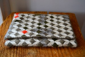 needlepoint clutch made by fergustuff
