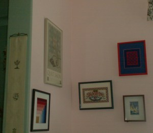 gallery wall of framed and mated needlepoint