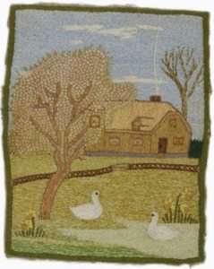 Embroidery depicting a French farmhouse