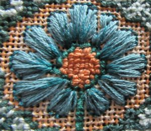Arts & Crafts flower needlepoint close-up