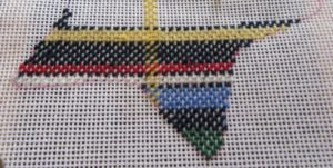 close-up of partially stitched needlepoint plaid