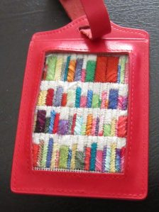 Planet Earth Fiber luggage tag with needlepoint
