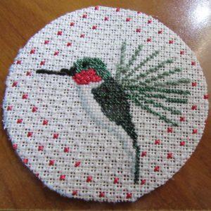 trimmed hummingbird needlepoint on cardboard back