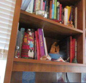 knick-knacks on bookshelf