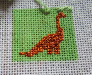 needlepoint dinosaur square