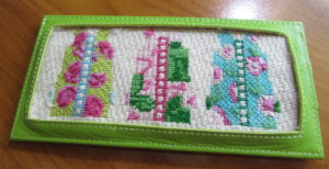 Two Sisters shist canvas needlepoint in Planet Earth long credit card case