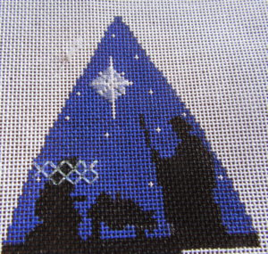 Kelly Clark nativity tree stitched with transparent threads