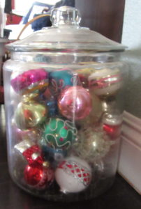 glass jar with vintage ornaments