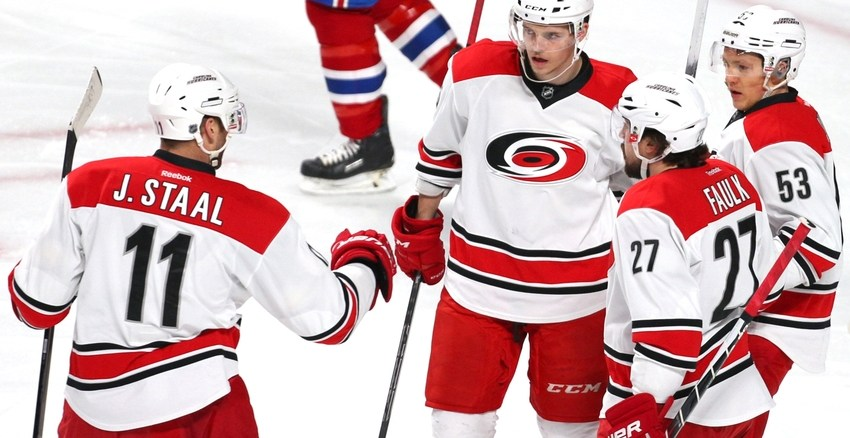 Feb 7, 2016; Montreal, Quebec, CAN; Carolina Hurricanes left wing Jeff Skinner (53) celebrates his goal against Montreal Canadiens with teammates during the first period at Bell Centre. Mandatory Credit: Jean-Yves Ahern-USA TODAY Sports