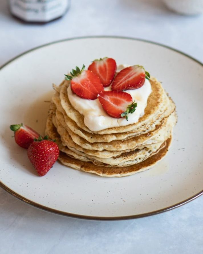pancakes with sliced strawberries on top