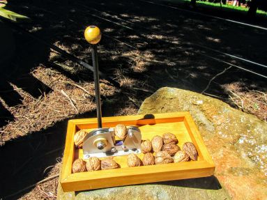 Base nut cracker on another rock