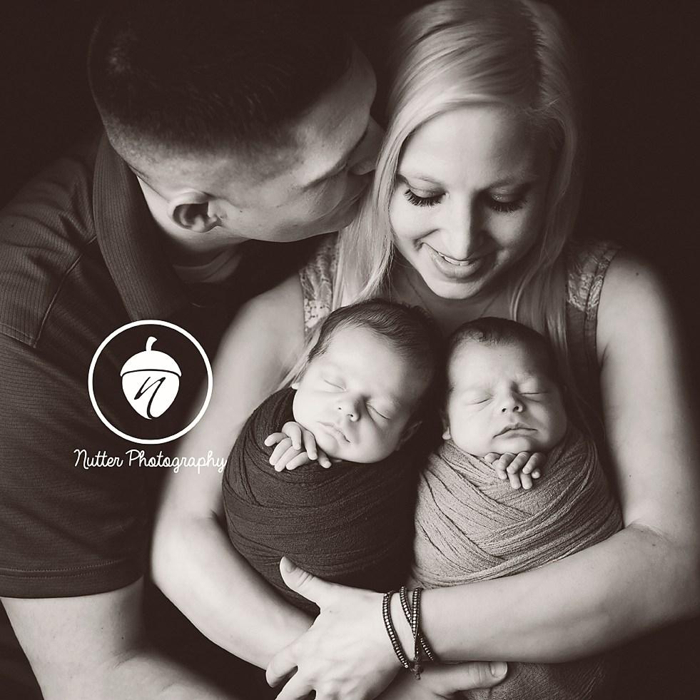 Newborn twins with family