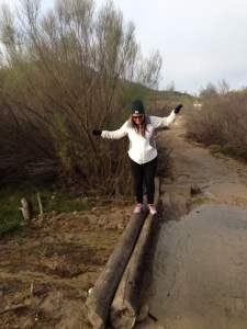 Teresa crossing logs at Dana Peak Park