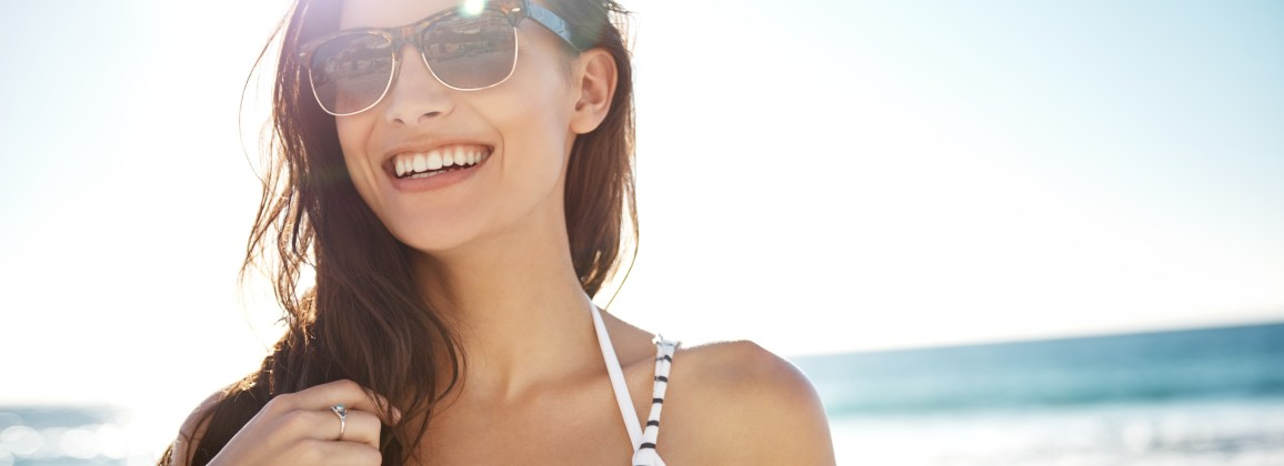 Woman at beach in sunglasses