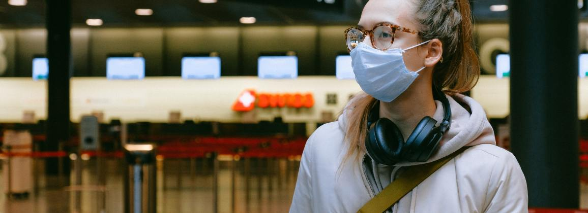 Woman wearing face mask and glasses