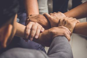 group of hands embracing