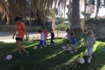 Soccer students following coach Maria's lead
