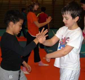 Kids practicing Aikido as part of non-violence training