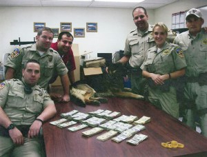 One of those typical photos where gang members show off their stolen loot.