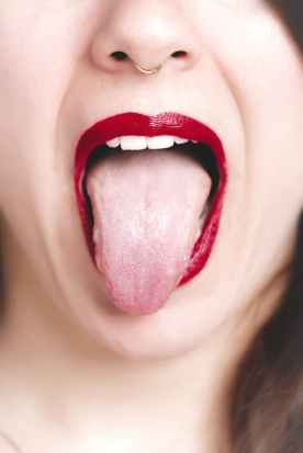 photo of woman showing her tongue