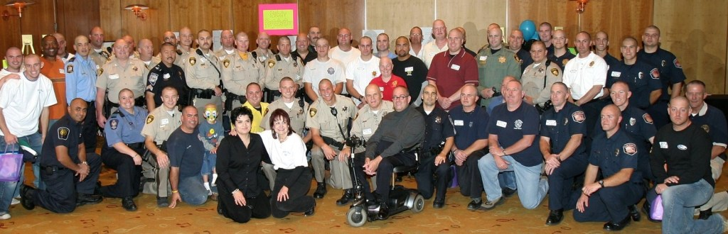 Law enforcement officers with shaved heads after participating in a PEP event