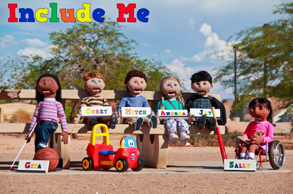 Include Me puppets arranged in a park setting