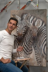 Danie Marais in his Studio with Motherhood painting