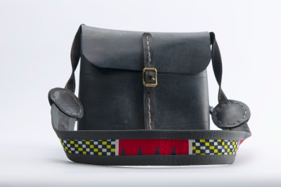 N&N Sling bag cover flap with buckle standing showing colour strap