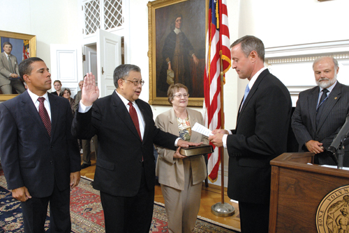 Edward Chow, Jr. is sworn in. From left to right: Lt. Governor Anthony G. Brown, Edward Chow, Jr., Sara McVicker, and Gov. Martin O'Malley.   (Photo provided by Maryland Governor's press office)