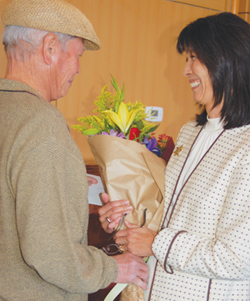 After honoree Sharon Tomiko Santos finished speaking to the audience, she got a surprise when her husband, Bob Santos, came onstage to give her flowers.