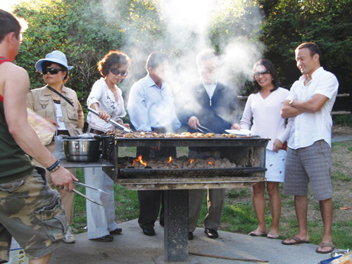 Competition participants and spectators waited in anticipation as kalbi — marinated meat — sizzled on the grill.