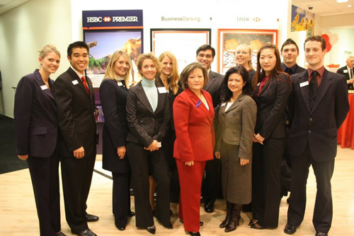 Notable members of the HSBC team (above) are Branch Manager Stacey McKinnon (far left), Business Relationship Manager Tiffany McVeety (third from left), Vice President and Senior Premier Relationship Manager Jenny Ning (middle, in red), and District Executive Ron Martinez (middle, in the back behind Ning).