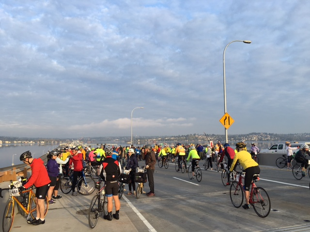 Bikers taking a break on the SR 520 Bridge.