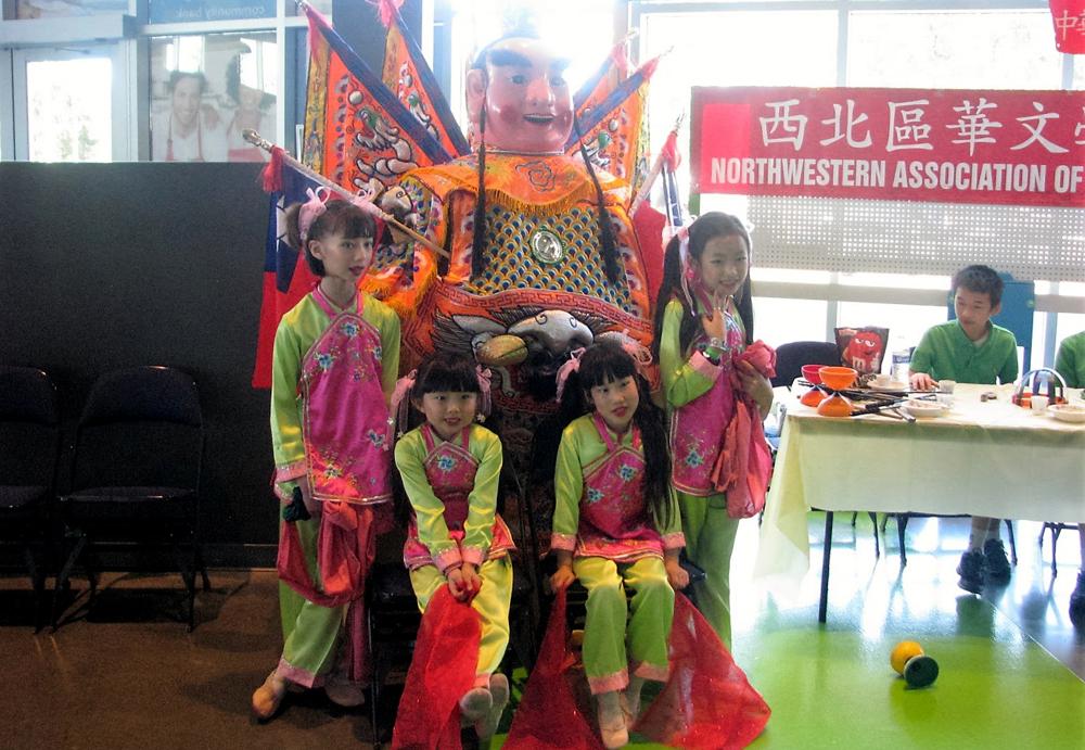 From left: Catherine Rasgaitis, Caroline Kao, Xinl Arnhold, and Nicole Tan of the South Puget Sound Chinese Language School wearing traditional folk dance costume. (Photo by Arlene Kiyomi Dennistoun/NWAW)