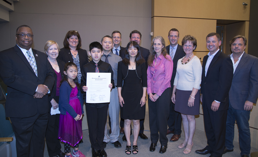 Edward Wan (5th from left) was recognized by the Metropolitan King County Council.