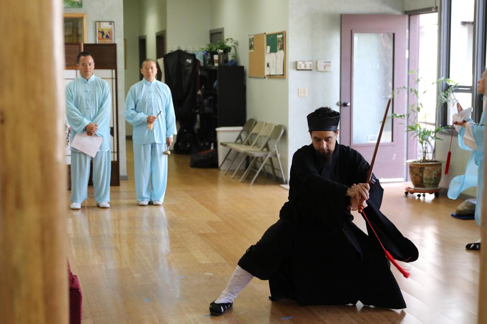 Mr. Chang performing ceremonial dance. (Photo by Dan Ehrlichman)